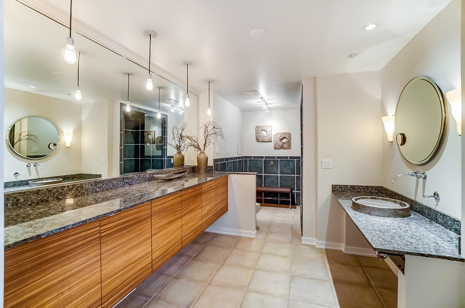 Custom cabinetry, granite counters and sophisticated finishes throughout.