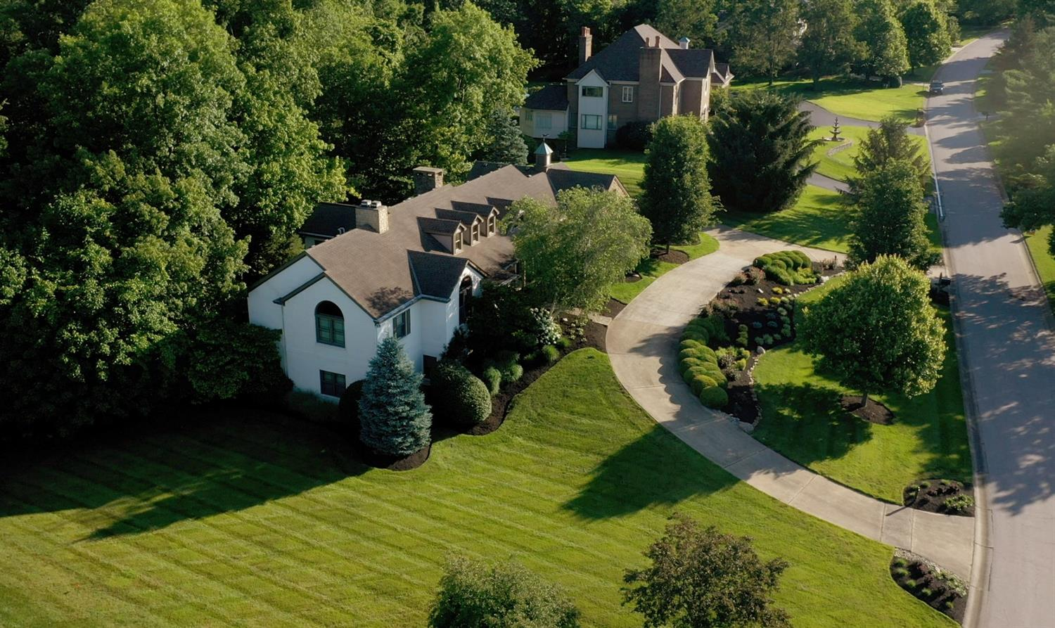 Elegant entrance to sprawling ranch with circle drive in Coldstream.