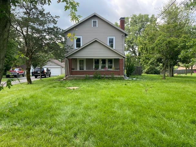 Country living close to the city. Nice 2 story with natural woodwork. Several out buildings with fencing on 3 sides perfect for horses. New leach lines and newer roof.