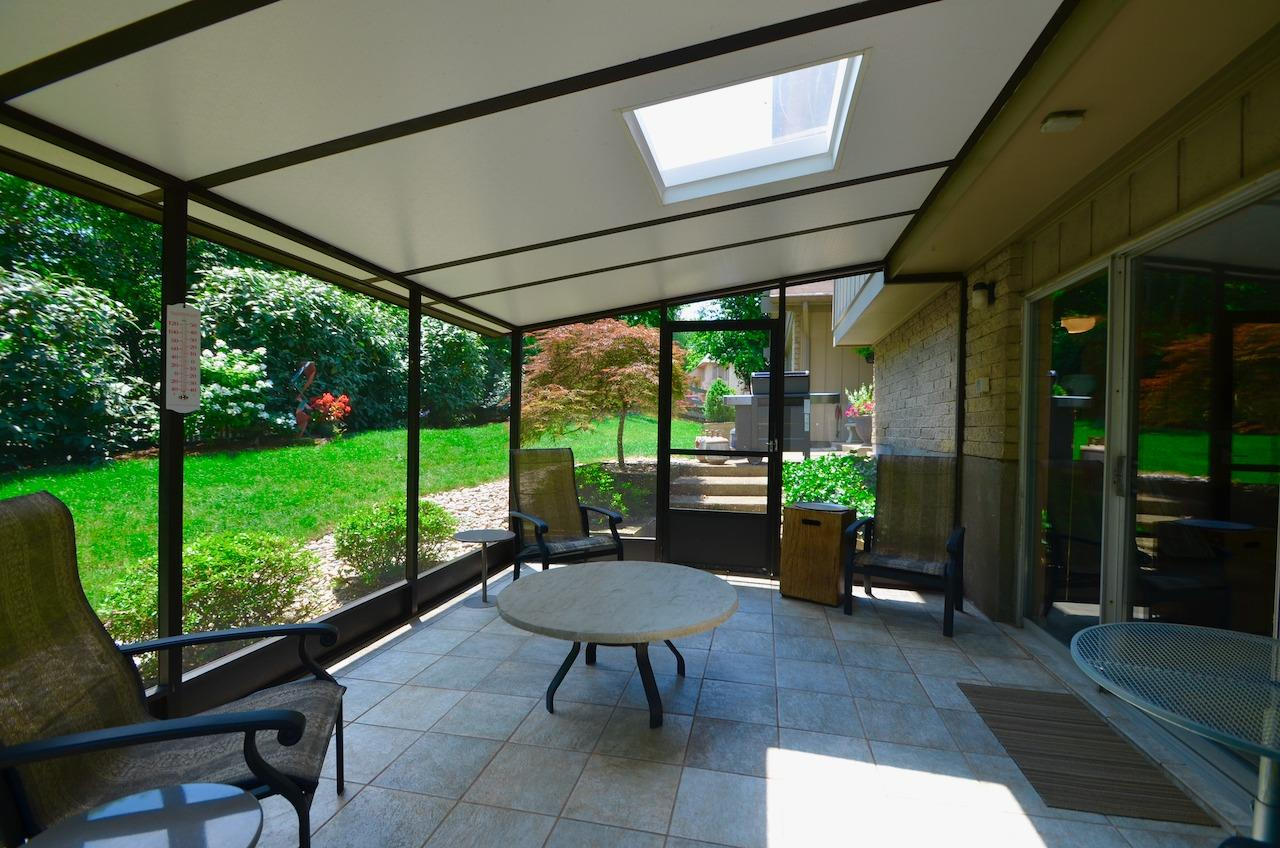 Screened Porch overlooks the fenced back yard.