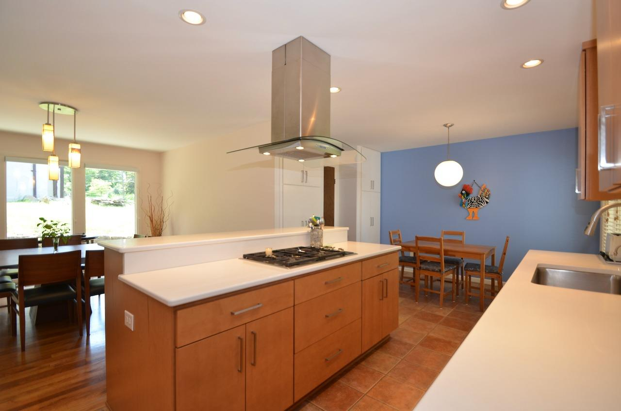 Completely updated and open kitchen area with counter bar and quartz counters.