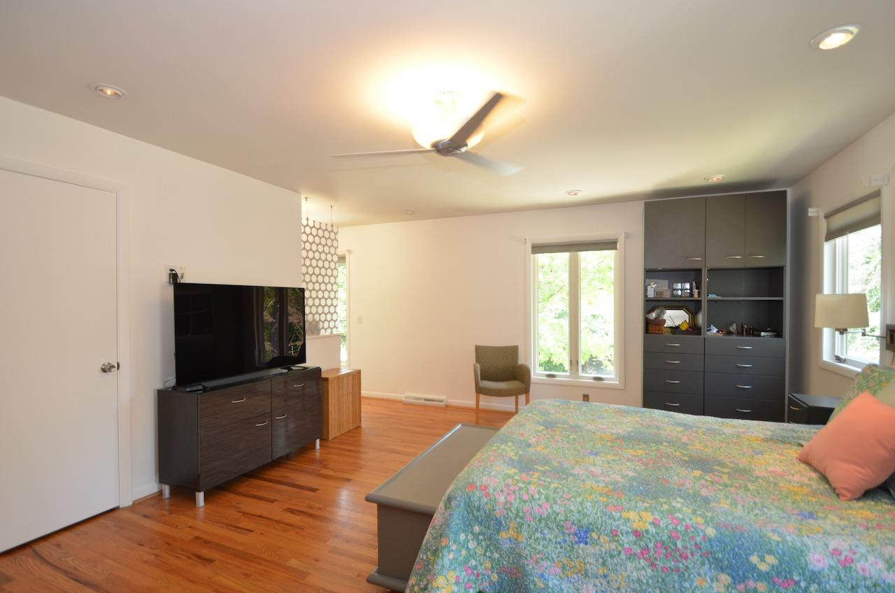 Another view of the primary bedroom.  There are also windows all around.  And custom blinds!