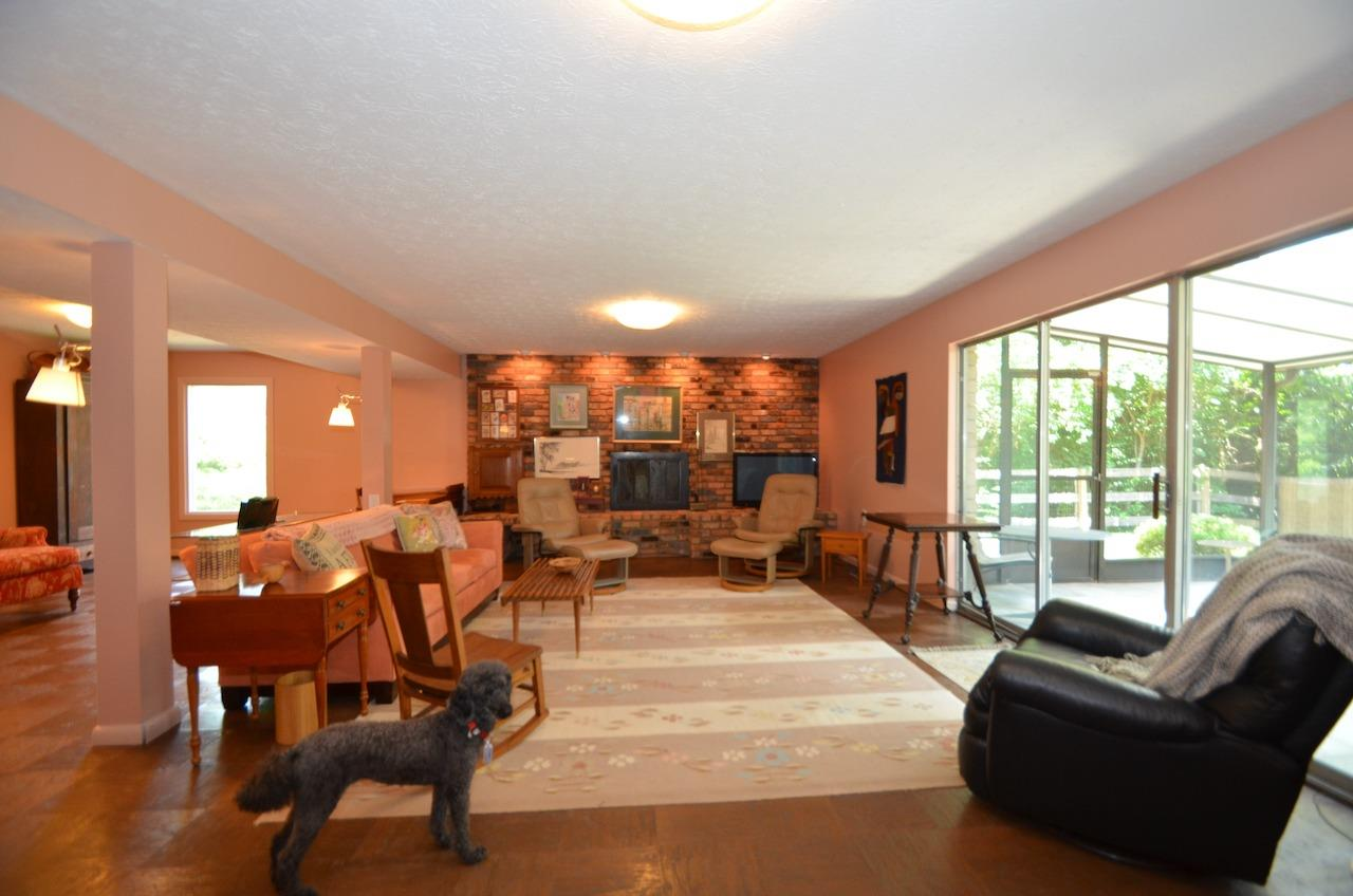 The family room opens to the beautiful screened porch!