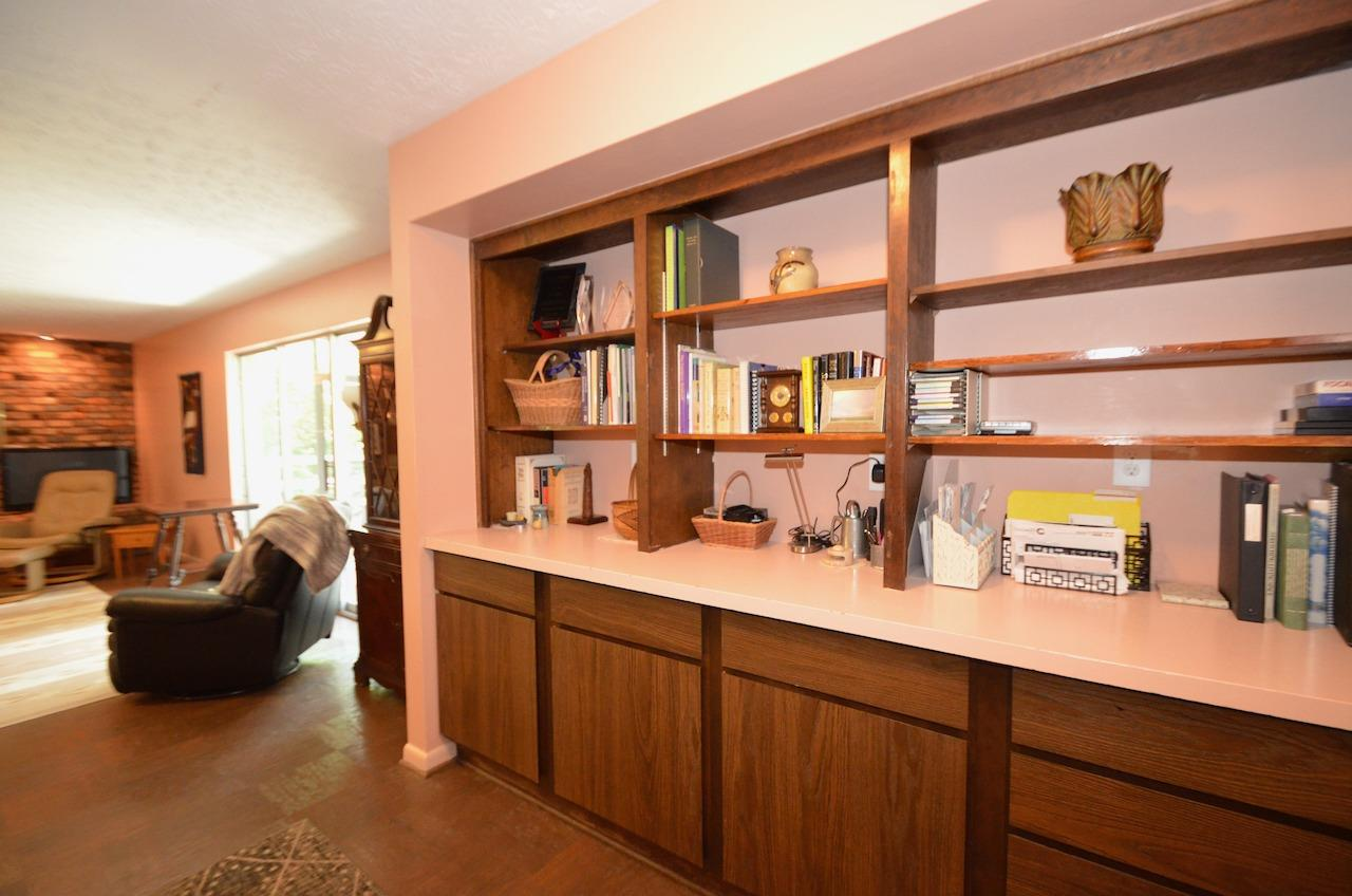 At the base of the stairway leading to the family room is this large built in book case & cabinetry. And across from the cabinetry is a closet.  SO MANY closets and storage areas in this home!!