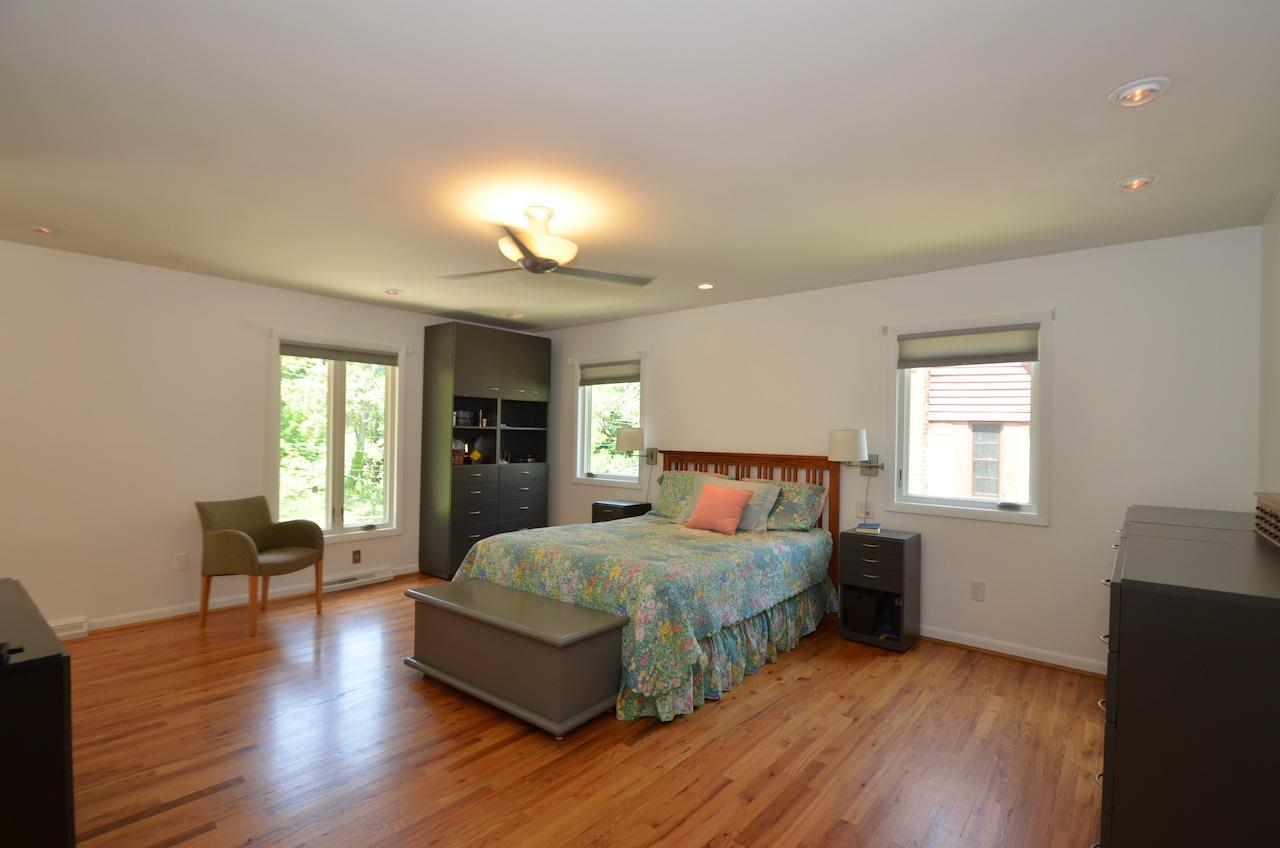 The primary bedroom suite is huge and contains a walk in closet and ensuite bath. And the entire upper level has beautiful hardwood floors.