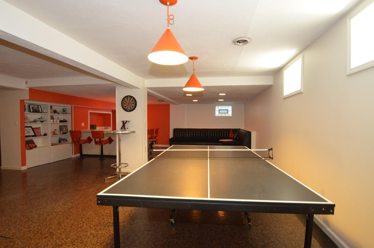 There is also plenty of room for ping pong! And remember how we mentioned the abundance of closets and storage?  There is a walk in storage area in this room as well!