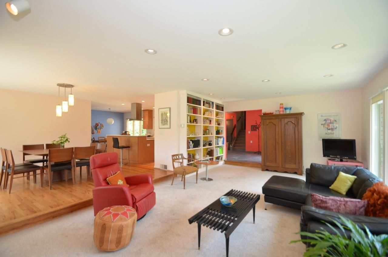 Nice open layout with sunken living room and built in bookshelves.