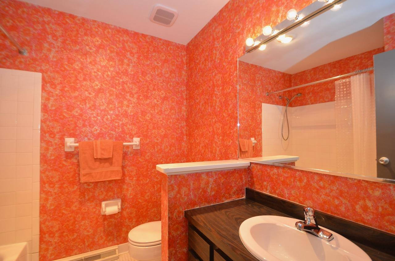 Upper level hall bath is also 70's retro-licious! This home has only had two owners and the current owner was careful to preserve as many of the original details as possible.
