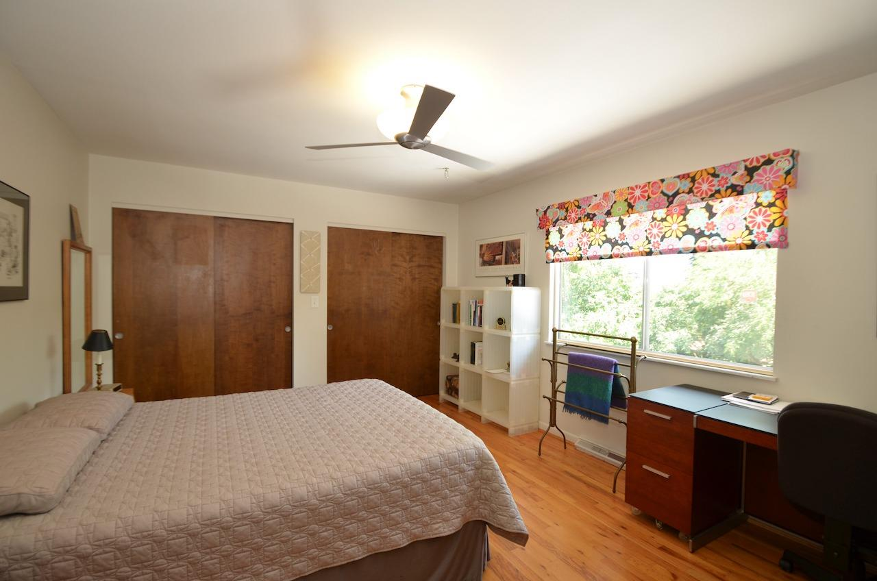 Bedroom 2 with two large closets overlooks the back yard.