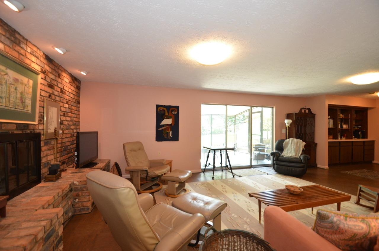 Back in the family room you can see the brick accent wall and wood burning fireplace.