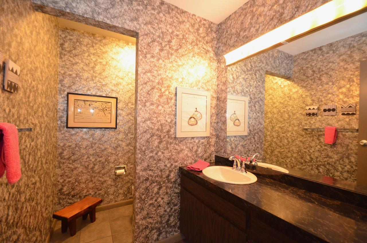 This home has some of the grooviest high end 70's bathrooms, including this spacious main level powder room.
