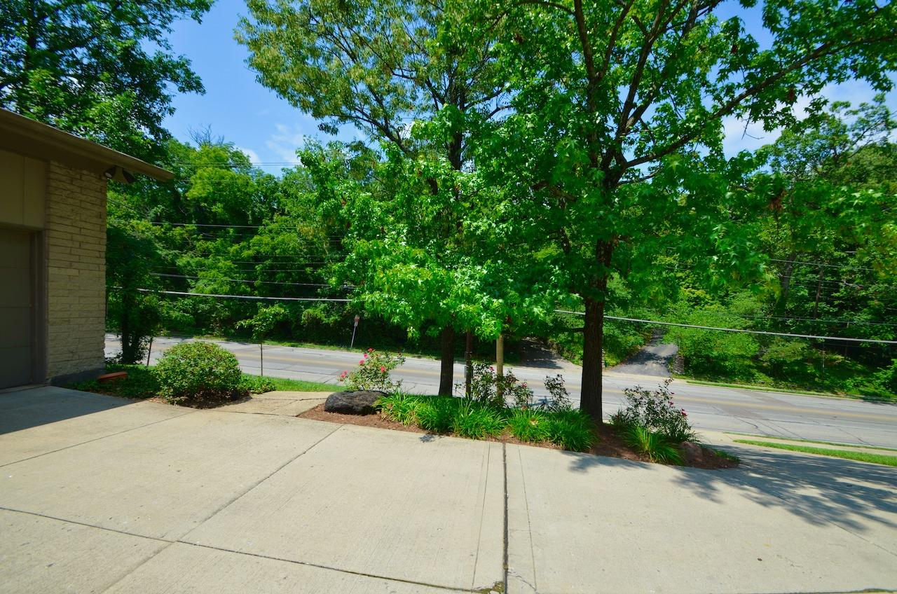 View of the street from the house.  There is plenty of off street and on street parking, including an oversized two car garage.  Paddock Road also has sidewalks!