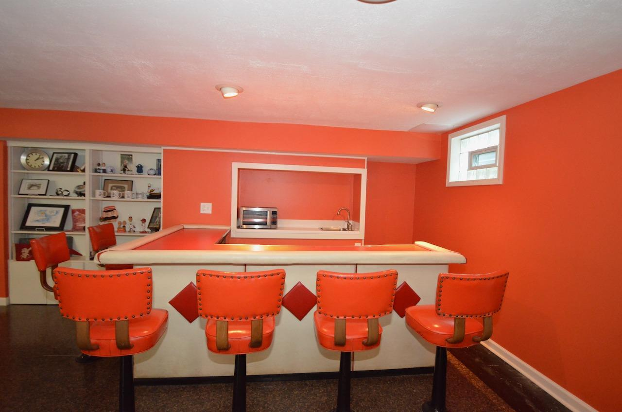 How cool is this wet bar with 6 built in stools!  Reds, Bengals & U.C. fans, these colors have you covered!