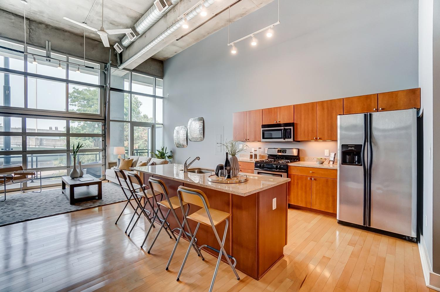 Eat-in kitchen with granite counters + stainless appliances