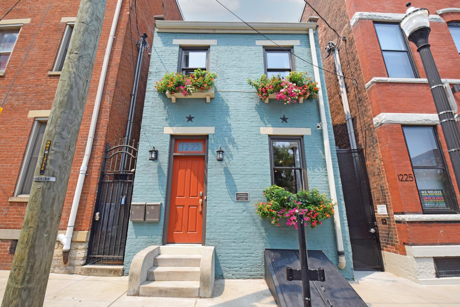 Beautiful restoration with private entry to Unit #1 at street level.  Unit 2 entry is through gate on side of building