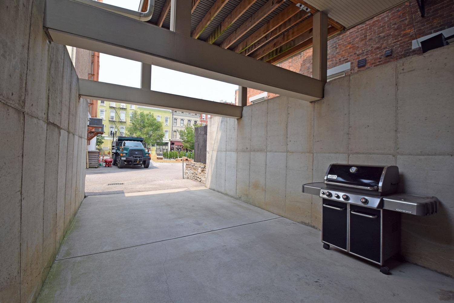 Covered tandem parking for 2 cars with rear access to kitchen