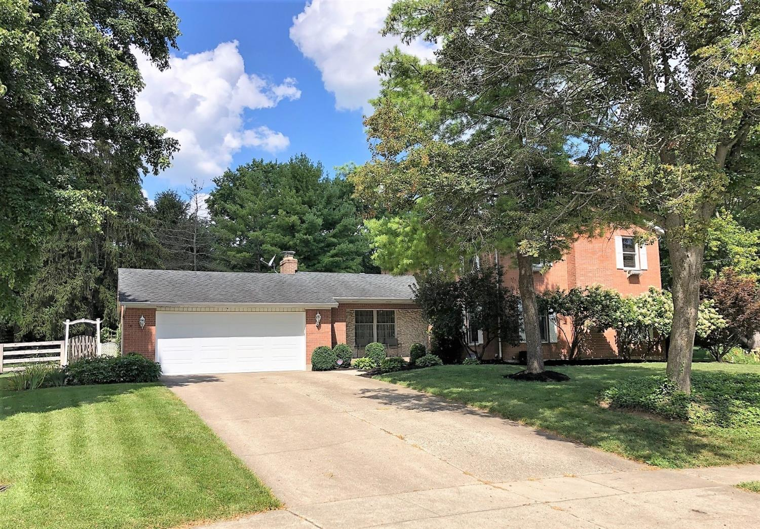 Gorgeous over 1/2 acre cul-de-sac lot in Rolling Hills! You'll find many custom features like oak pegged hdwd flrs, built-in bookcases, Anderson windows, 2x6 walls, and a spectacular Amish solid cherry kitchen w/granite! This 4 bdrm 4 bath home has a fantastic finished lower level with endless possibilities for entertaining, relaxing, exercising, theatre rm, kitchenette, whatever your needs are! HVAC new in 2013, Roof 2010, Windows 2008.  Backyard is huge with fence, deck, pergola & paver patio!