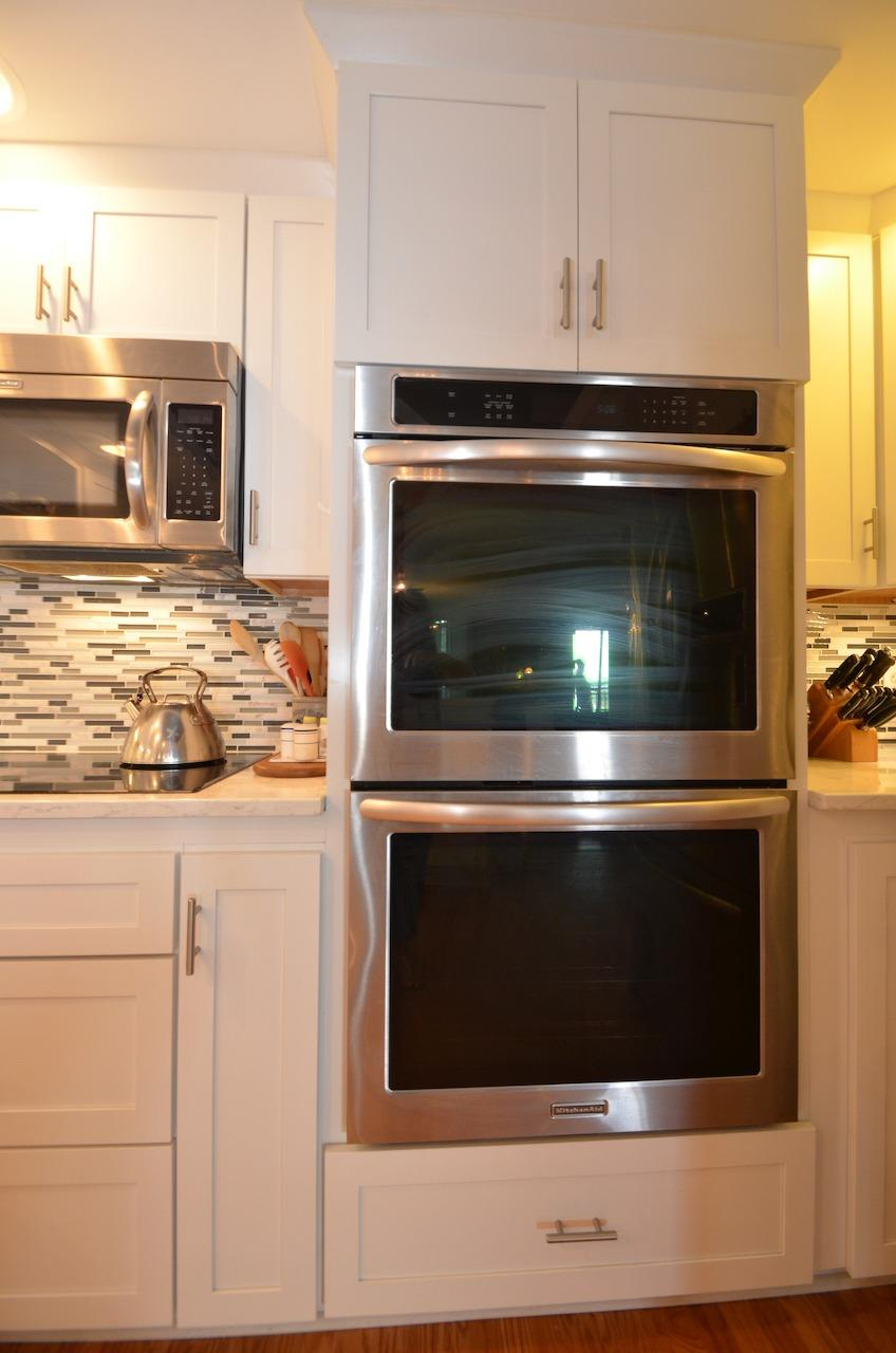 Large double wall oven next to the built in microwave and induction cooktop.