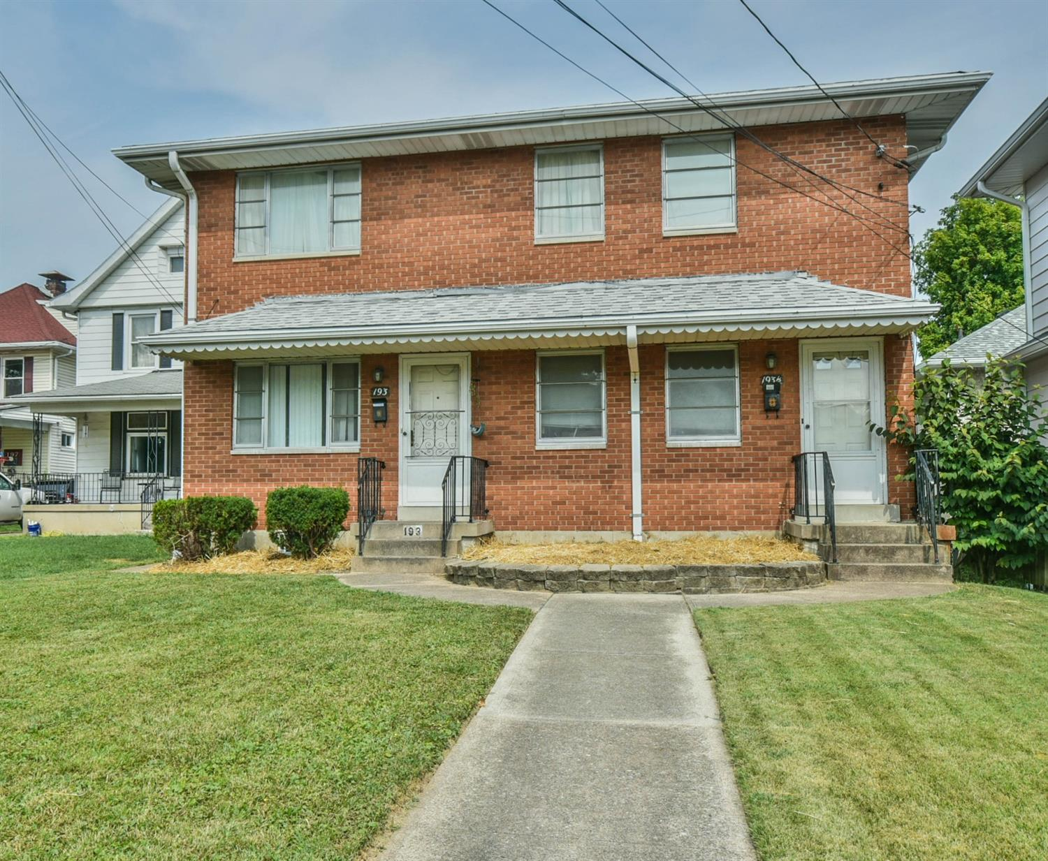 Location, location, location!  Great duplex with both units having two bedrooms.  Huge four car garage on rear of the property.  Perfect location for air BandB for Spookynook.  Separate utilities and fenced in back yard.  Washer and dryer hookups in the basement.
