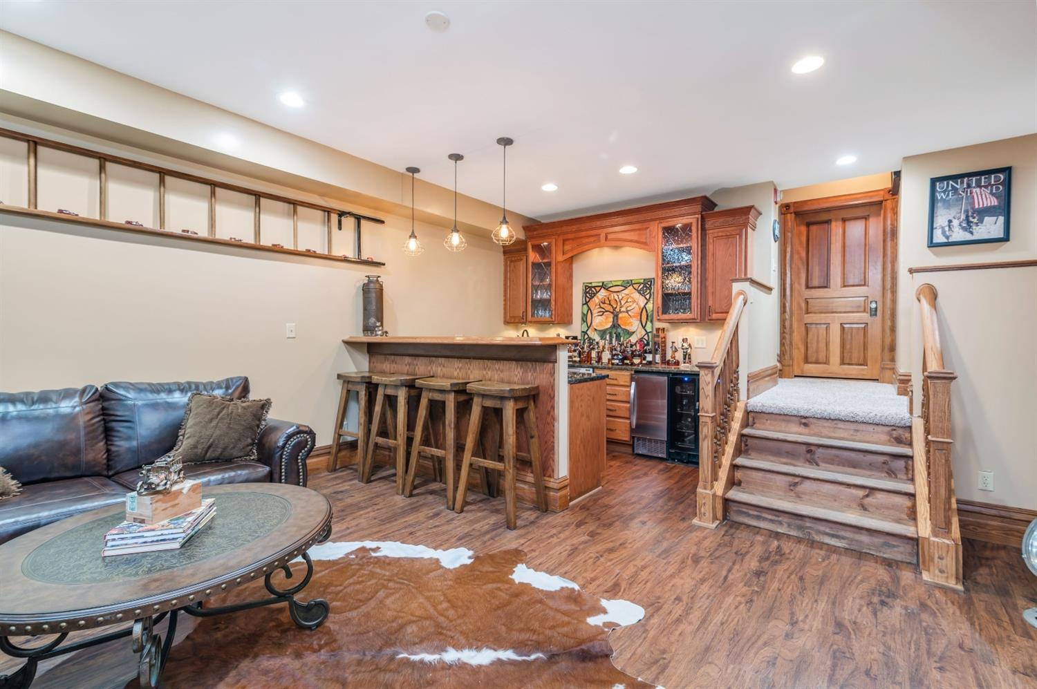 Lower level studio/man cave suite offers a full kitchen.