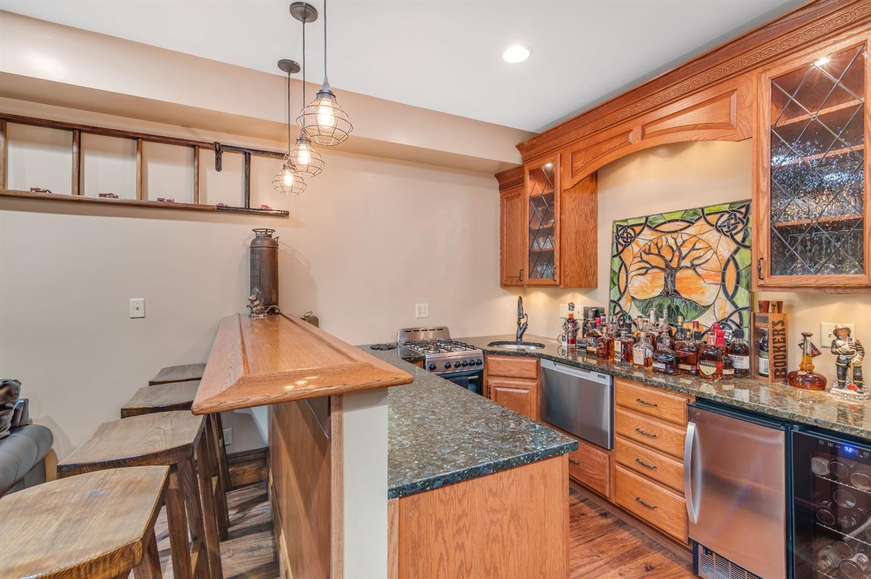 Kitchen bar includes gas range, drawer dishwasher and ice maker wine fridge.  Bourbon not included so BYOB!