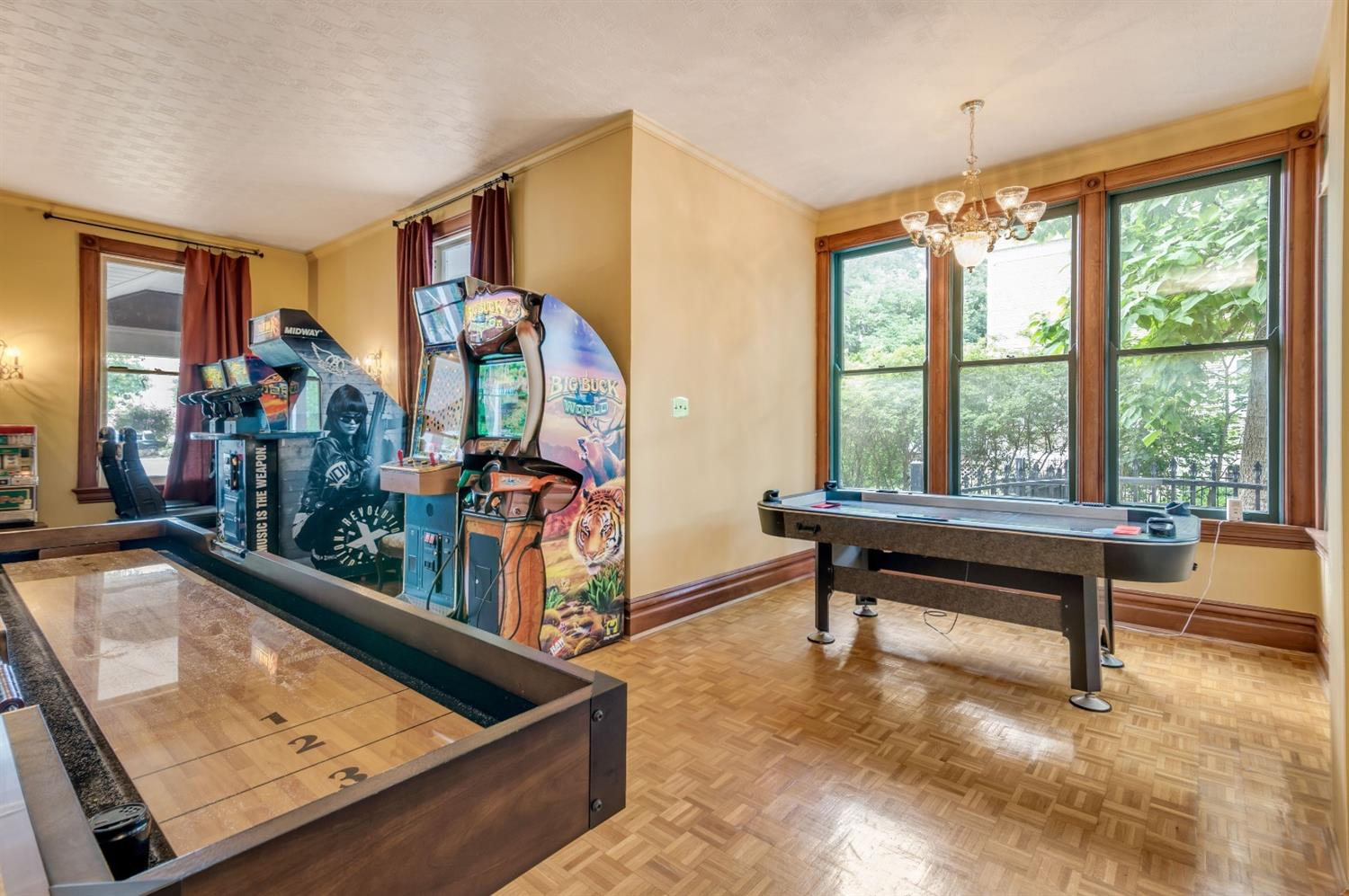 Lots of room to make this living room your own vision.  This home includes 3 family rooms, you'll have fun deciding what to do!