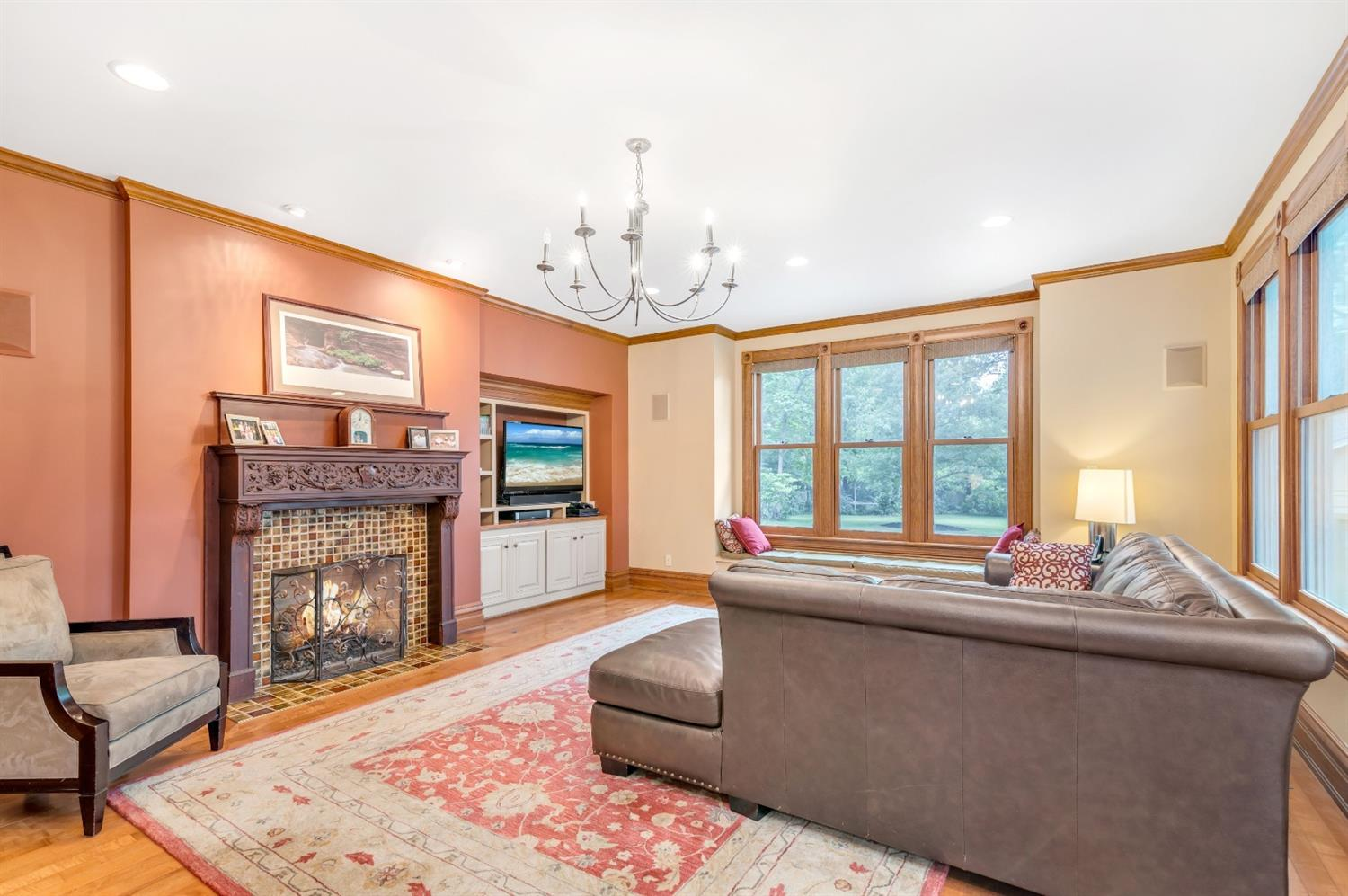 Located off the kitchen this light filled family room opens to a spacious deck and private yard.