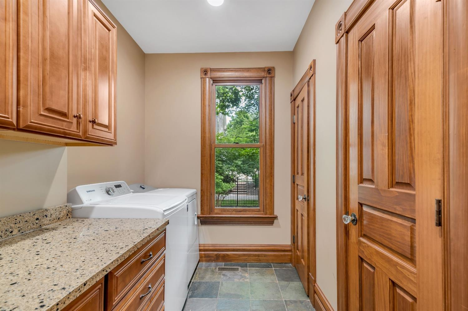 This home offers 1st and 2nd floor laundry rooms.  This 1st floor laundry is spacious and offers the room you need for organizing.
