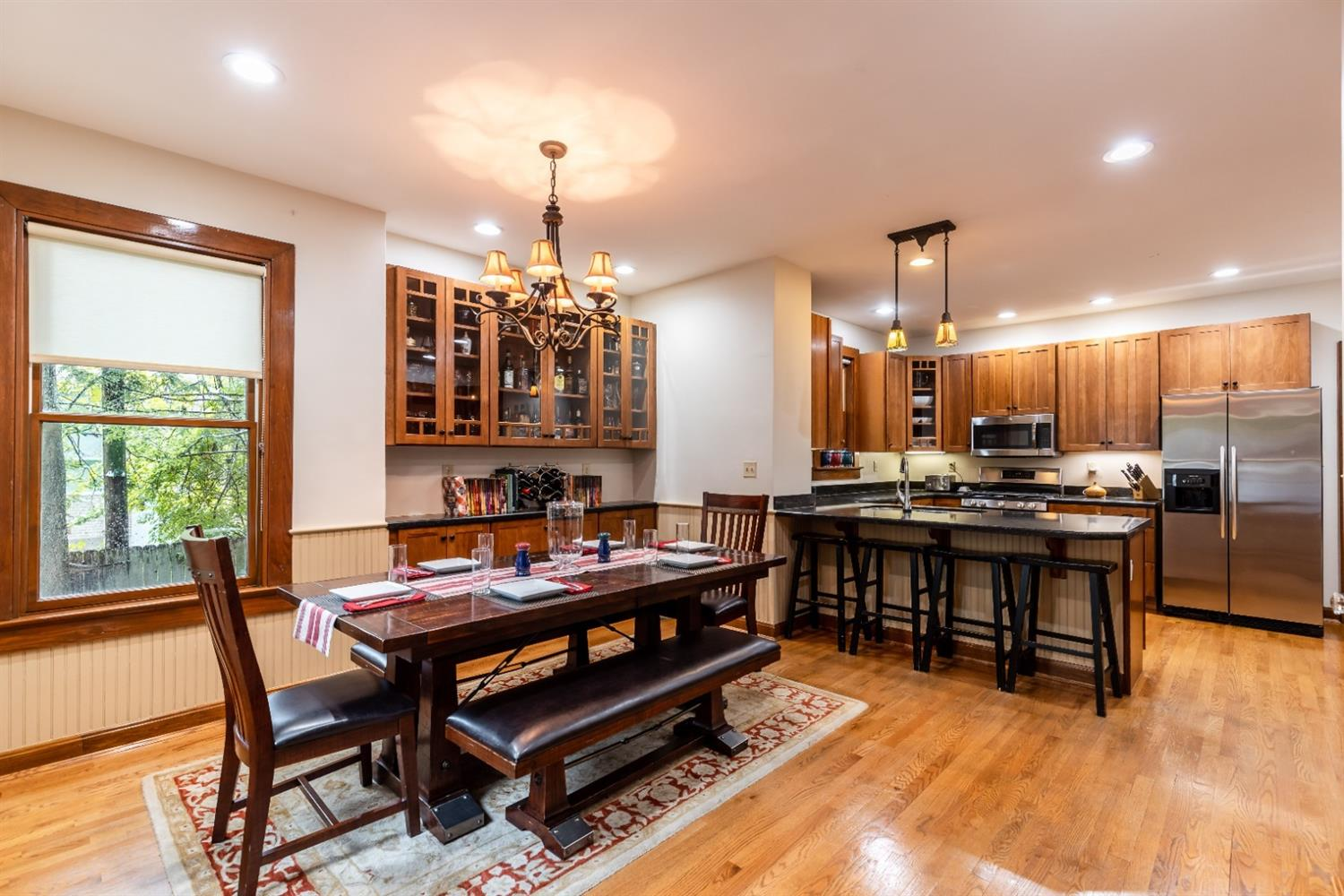 Spacious eat-in kitchen adjoins family room and dining room.  Stainless appliances, gas range, granite counter tops and wood cabinetry.