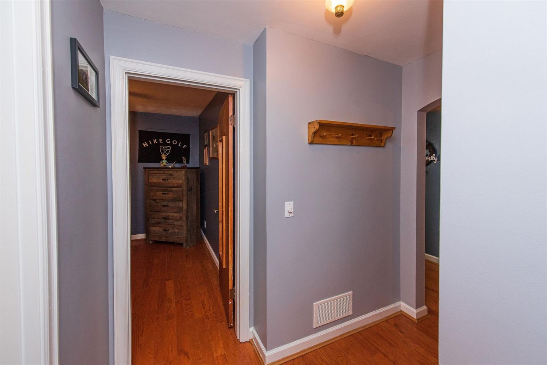 Wide hallway accessing both bedroom and bathroom.