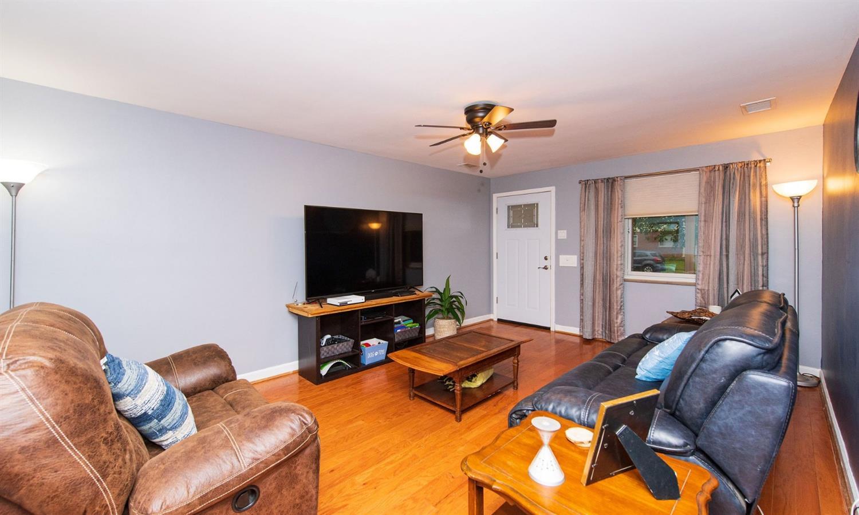 Spacious living room with Pergo hardwood flooring.