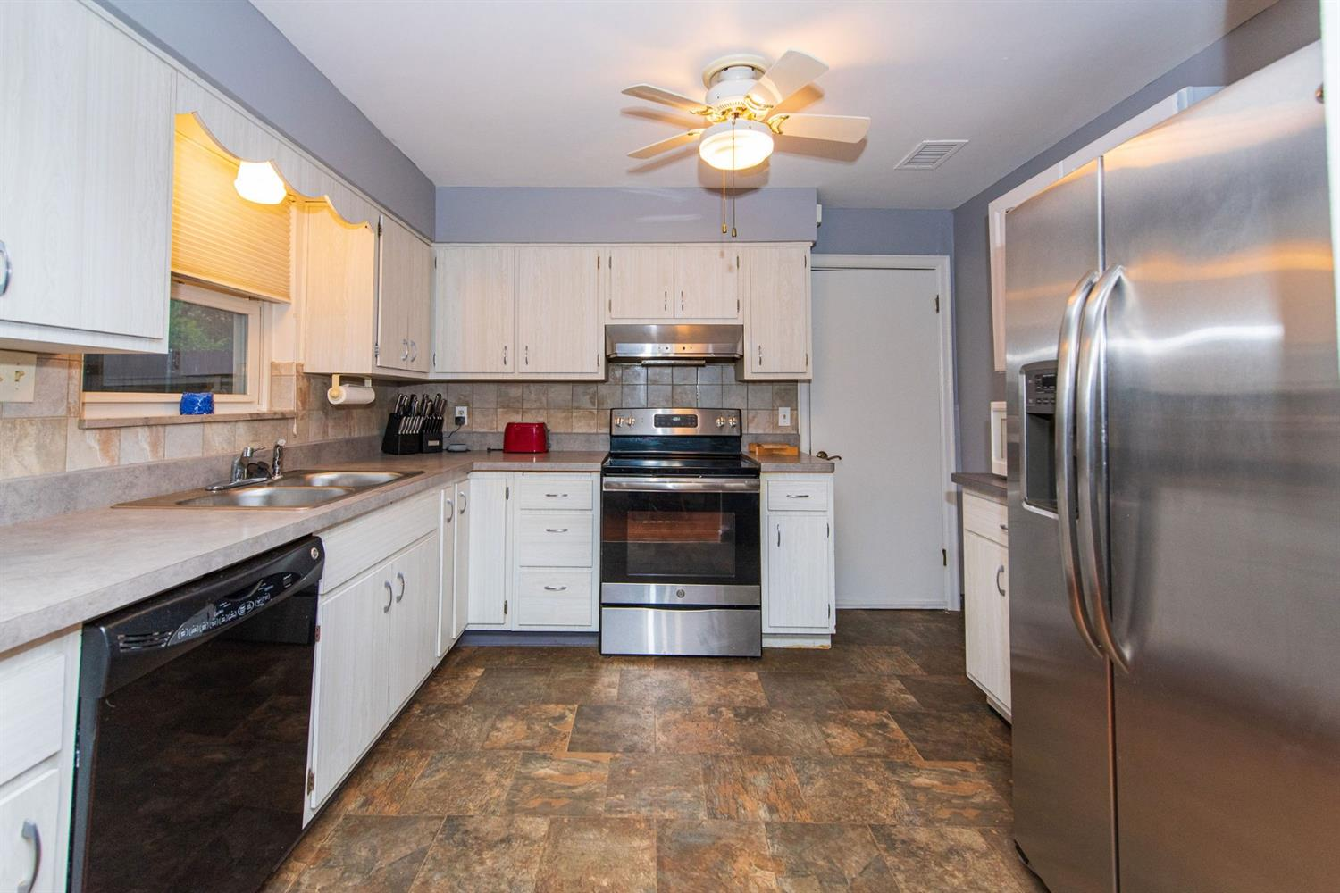 Fully equipped Kitchen with stainless steel appliances. Laundry room and attached garage off kitchen.