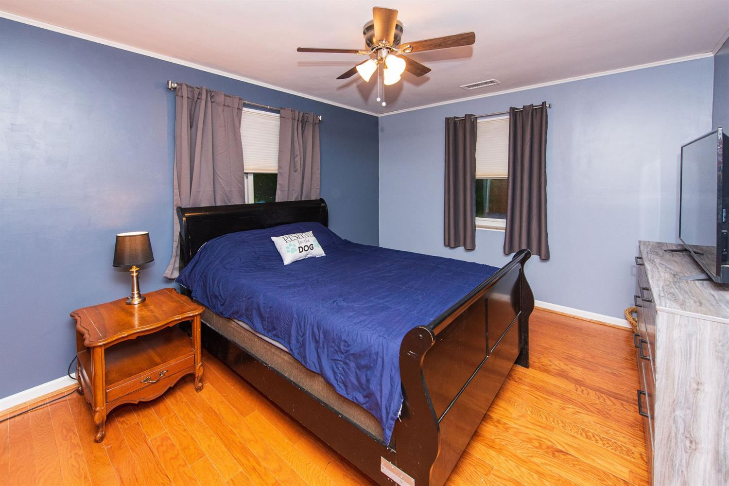 Master bedroom with double closets and Pergo hardwood flooring.