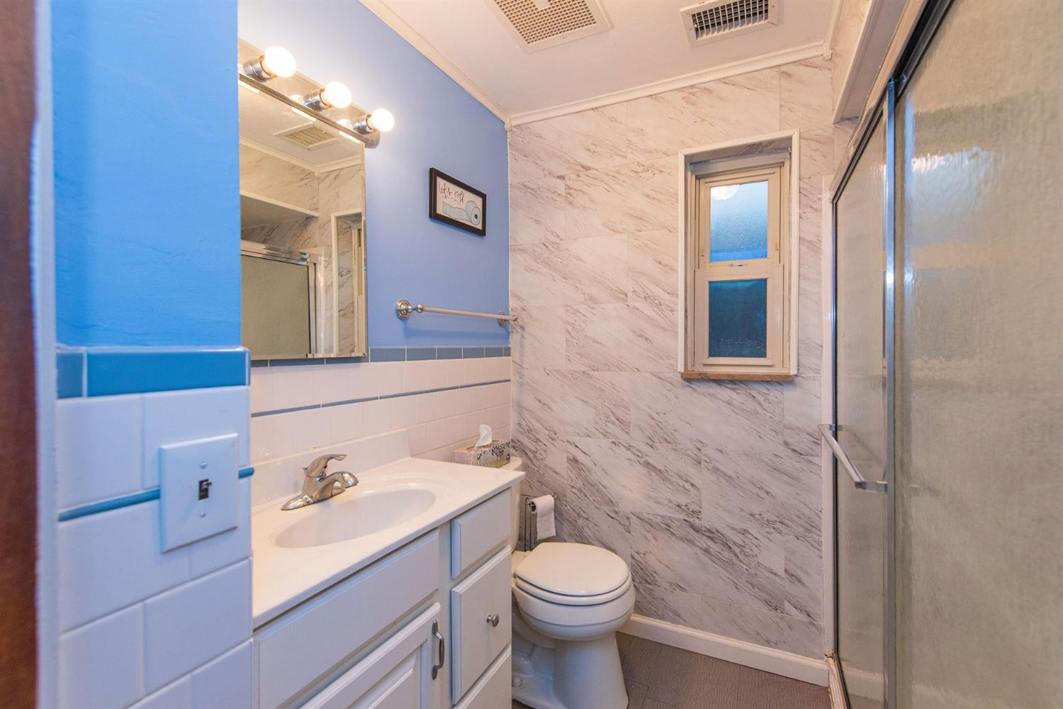 Updated bathroom with linen closet. Standup shower with attached grab bars and seat.
