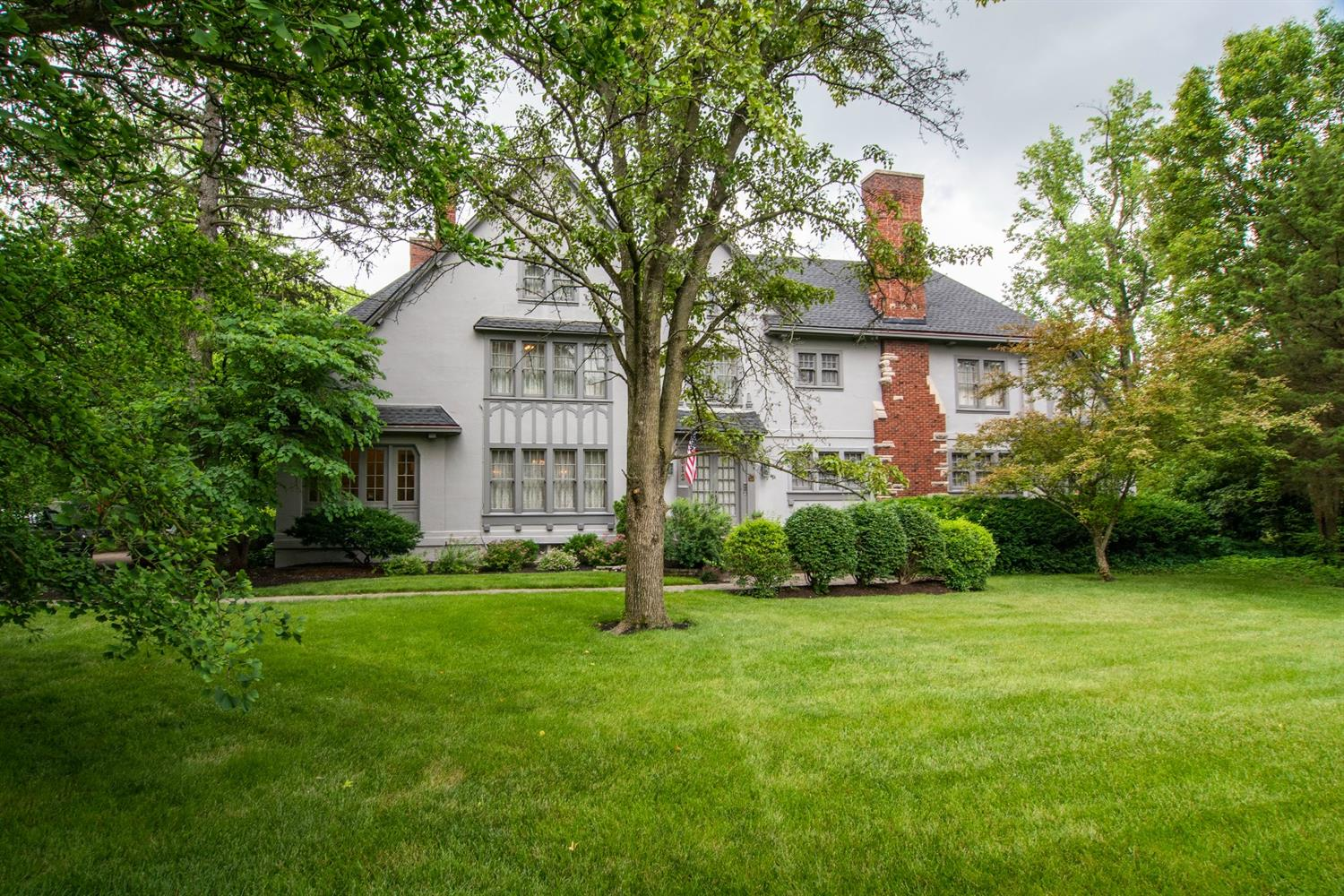 EXQUISITE! APPROX.8,500SQFT! 3STORY,7BD,4.2BATH,FULL POURED BASEMENT W/WO! 2CAR OVERSIZED DETACHED GARAGE! .991ACRE! PRIVATE PARK LIKE SETTING! GRAND 2STORY FOYER W/VESTIBULE! TOTALLY RENOVATED GOURMET KITCHEN W/2BUTLERS PANTRIES,CUSTOM BUILT AMISH SOFT CLOSE CABINETS,TILE COUNTERTOPS & BACKSPLASH,STAINLESS STEEL APPLIANCES & WO TO SERVICE PORCH! BREAKFAST RM! HUGE FORMAL DINING RM! FORMAL LIVING RM W/ROOKWOOD FP & ORIGINAL CUSTOM BUILT-INS! 4SEASONS RM W/WO TO PORCH! 1ST FLR DEN W/BEAMED CEILING & FP! 1ST FLR SUITE W/BD,FULL BATH,LIVING RM,KITCHEN & WO TO PORCH! 2ND FLR MASTER  W/2WALK-IN CLOSETS,WO TO BALCONY & ADJOINING MASTER BATH! LARGE BDRMS & CLOSETS! 2ND FLR W/LAUNDRY & SLEEPING PORCH! 3RD FLR W/2BDRMS,FULL BATH,LIVING RM,KITCHEN & STORAGE(ATTIC&CRAWL SPACE)! LOWER LEVEL W/LAUNDRY,WRKSHP,FUEL&BOILER RM,STORAGE & WO! REFINISHED HARDWD FLRS!ORIGINAL DRS & KNOBS!ROOF2019!COMMERCIAL GUTTERS!BOILER2016!NEWER DRIVEWAY&PAVERS