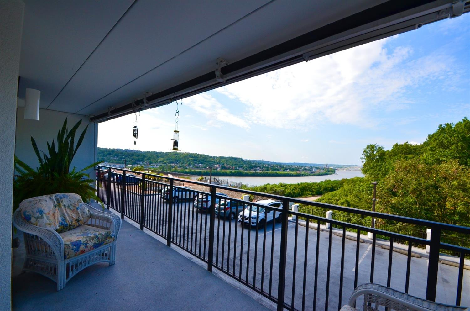 And here is that private RIVER VIEW balcony!  There is also a power awning to give extra sun protection with automatic wind sensor that closes awning so it does not suffer damage.  Who even knew that was a thing?! You have a year round view of the Big Mac bridge every day and FIREWORKS on special occasions!