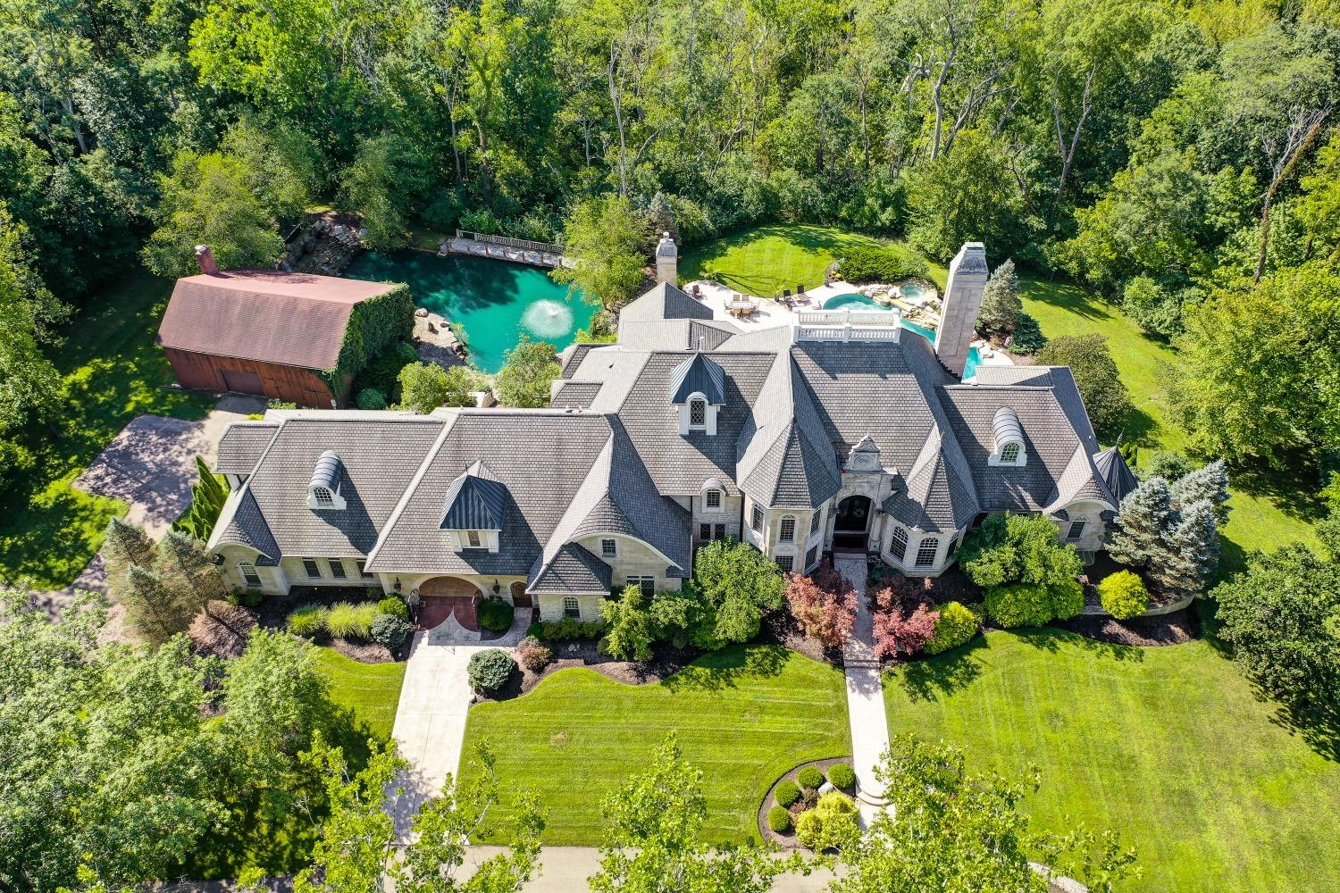 This exquisite estate was custom-built with the highest-quality materials and workmanship and sits on 5.8 acres with manicured beds and mature trees.