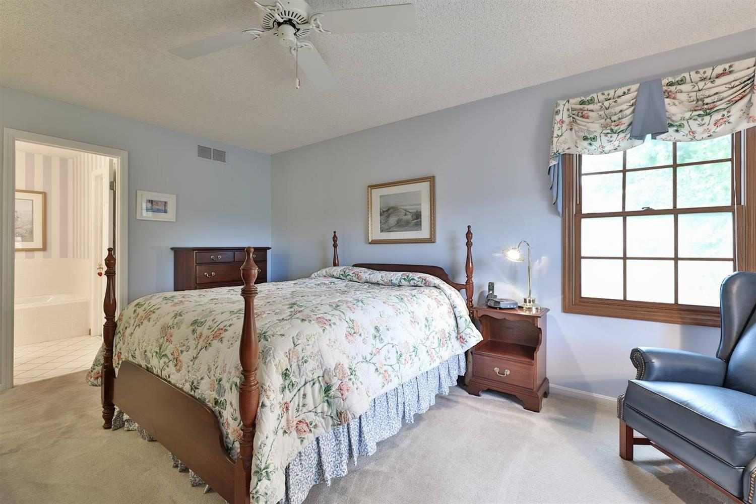 Master suite with ceiling fan, attached full bath.