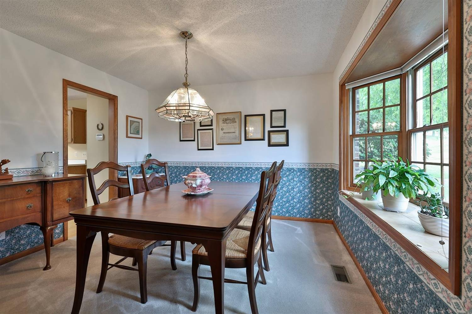 Dining room with bay window and window seat.....