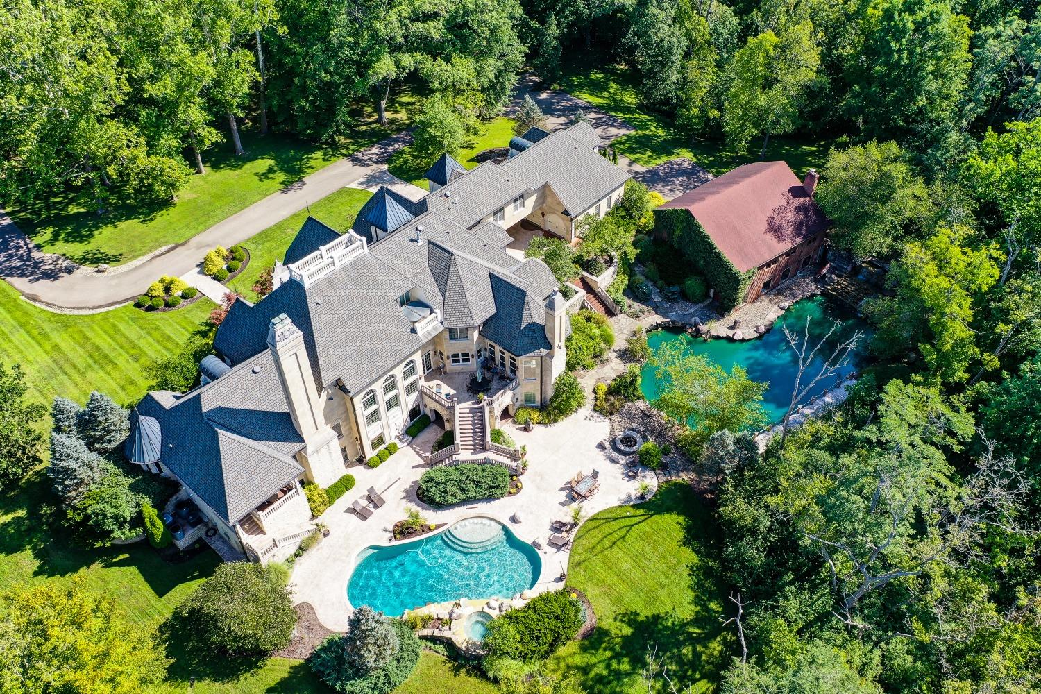 The outdoor kitchen, stocked pond, Gunite pool, hot tub, fire-pits, barn, multiple porches and terraces were all designed with outdoor entertaining in mind.