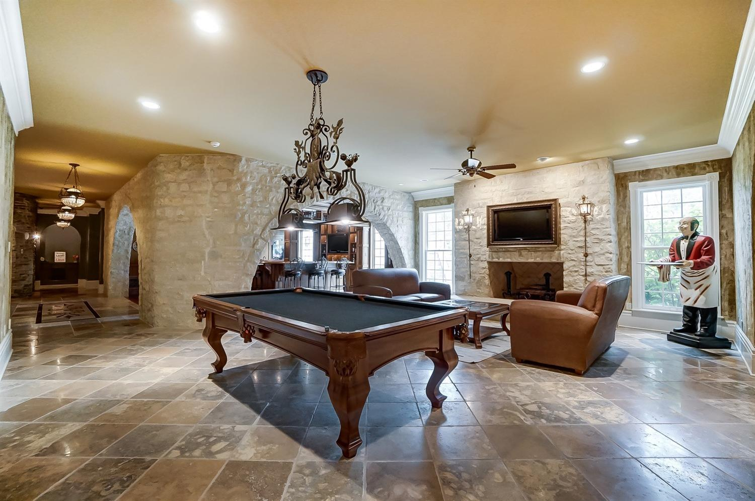Adjacent to the tavern is the lounge room with a billiard table and large stone wood-burning fireplace with a raised limestone hearth.
