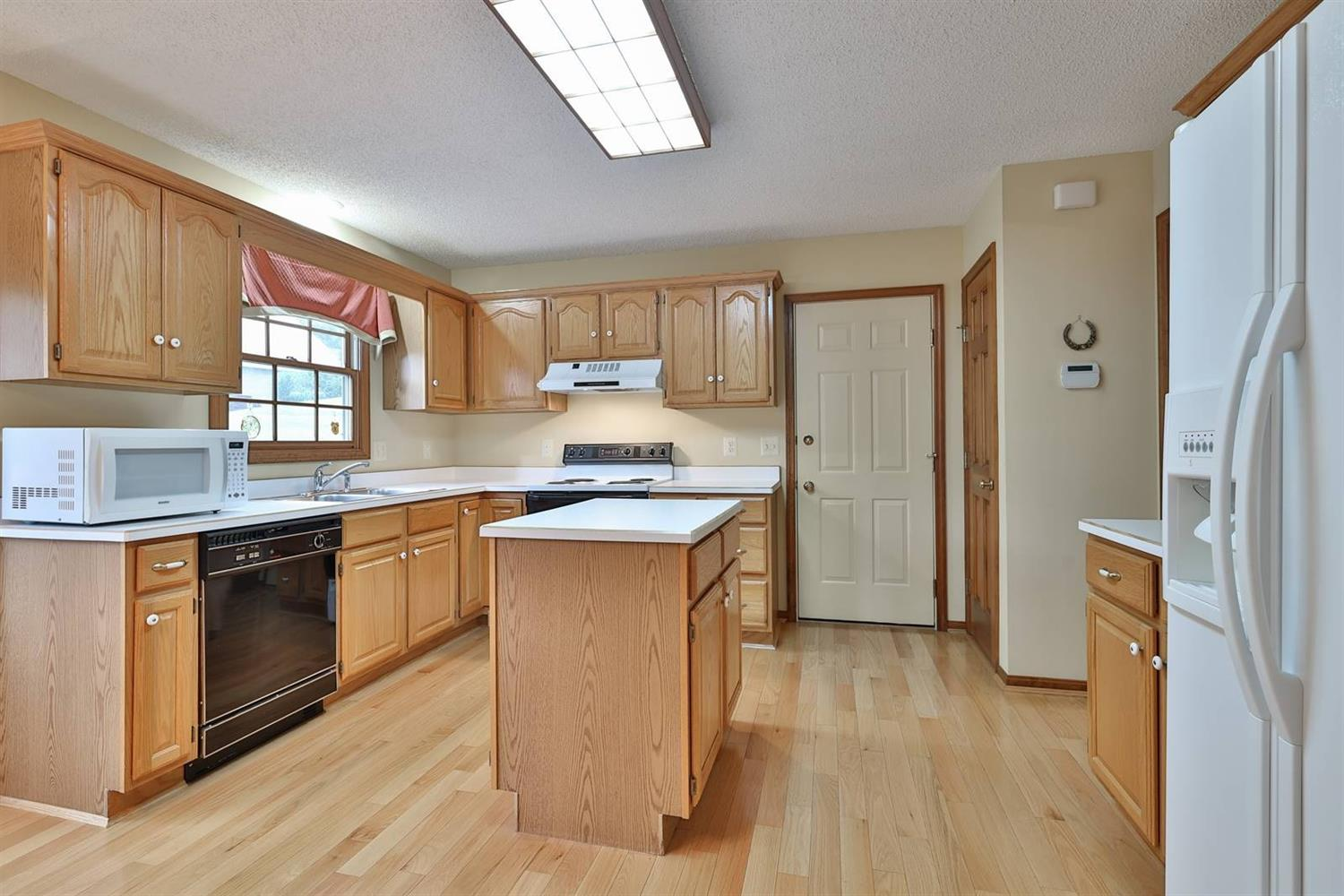 Enjoy the hardwood floors and a window over the sink that looks out at the backyard....