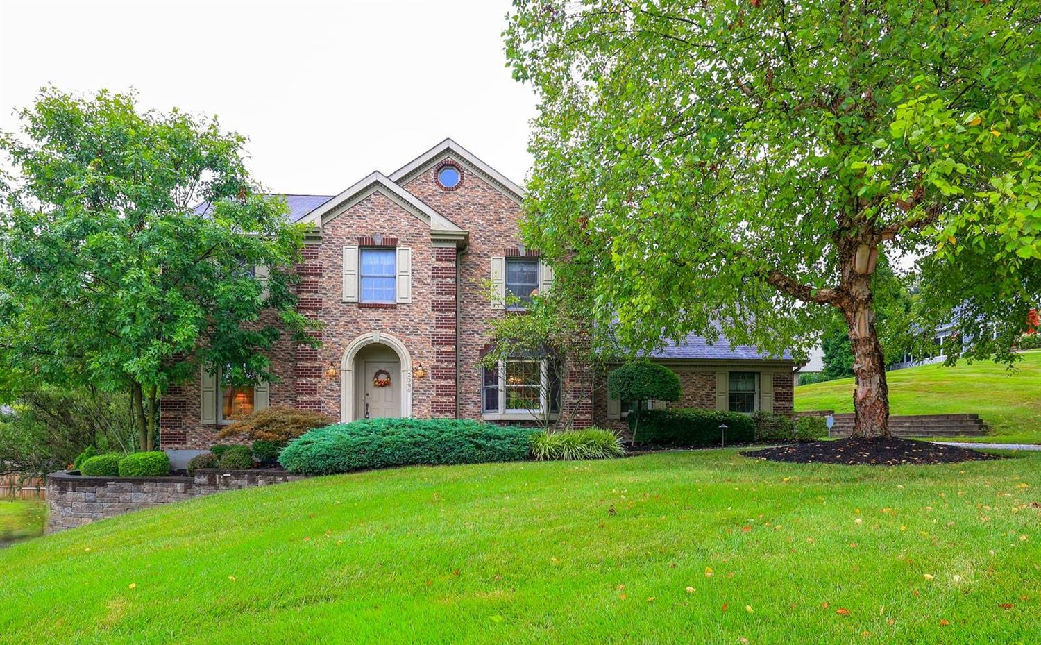 Beautiful Brick Exterior with manicured, mature landscaping.