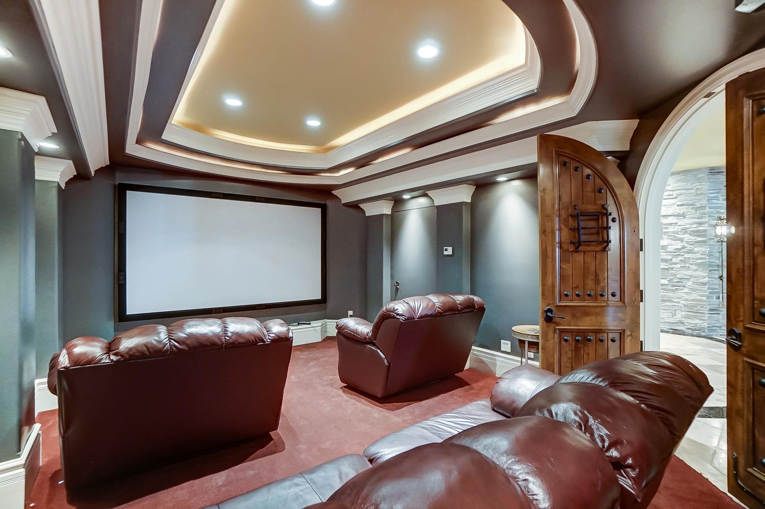The theater room is adjacent to the tavern.