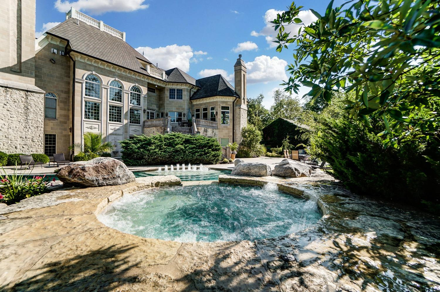 Water cascades from the hot tube to the heated Gunite pool.