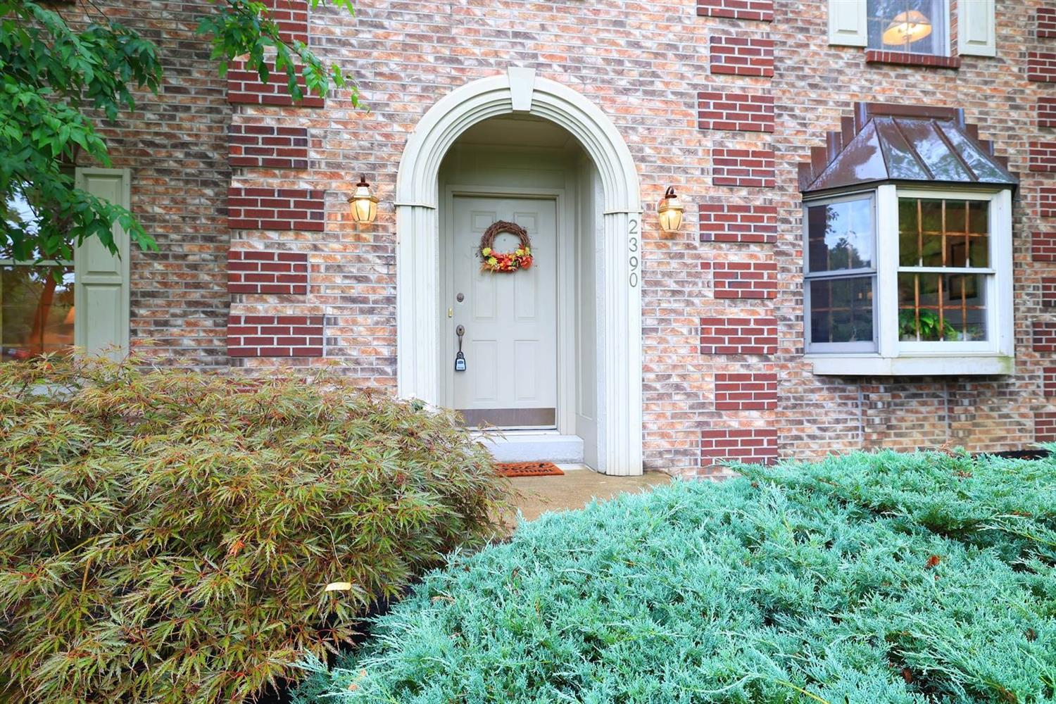 Charming keyhole front door!  Perfect backdrop for your Fall pumpkins and mums.