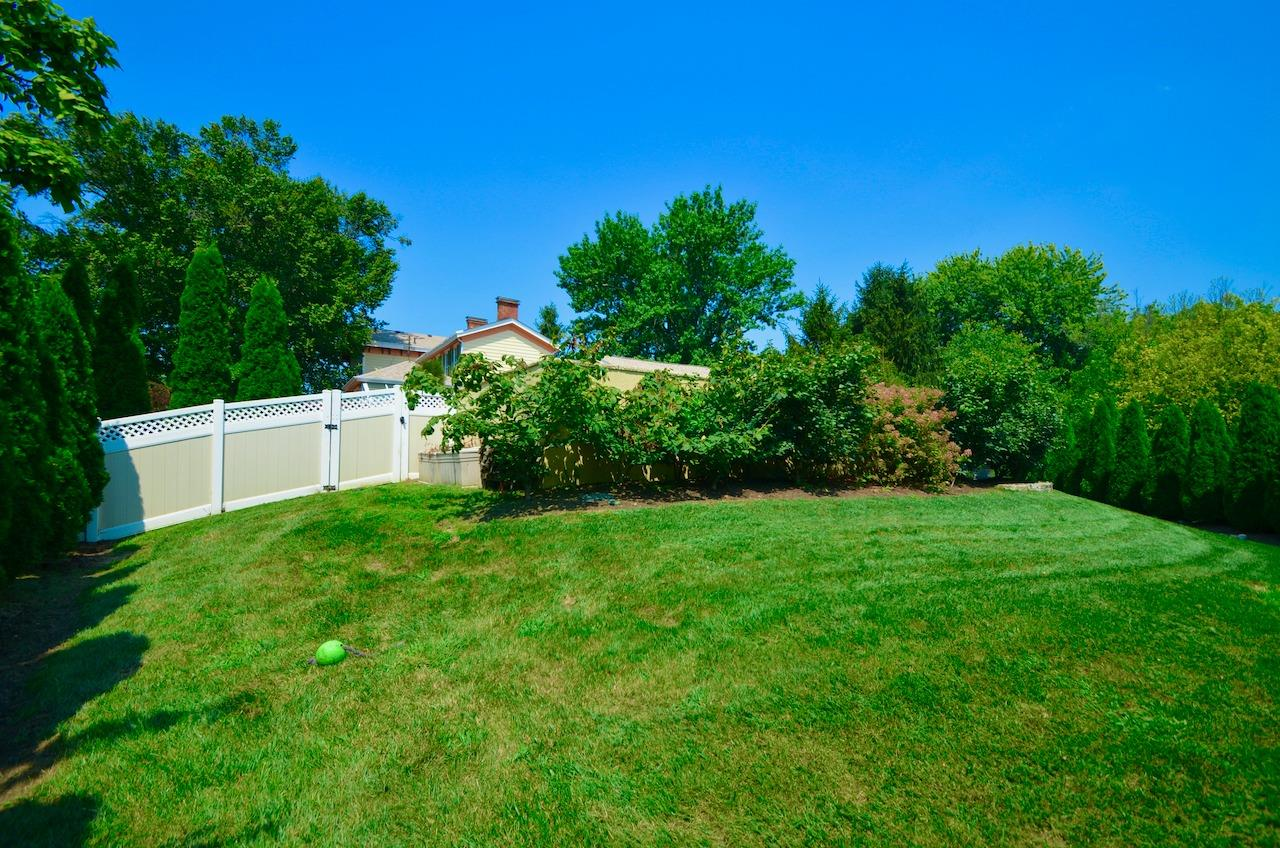 Here is the other side of that gate we were just looking at.  This is the back yard that is not part of the landscaped and pool area.  Total lot size is .643 acre.