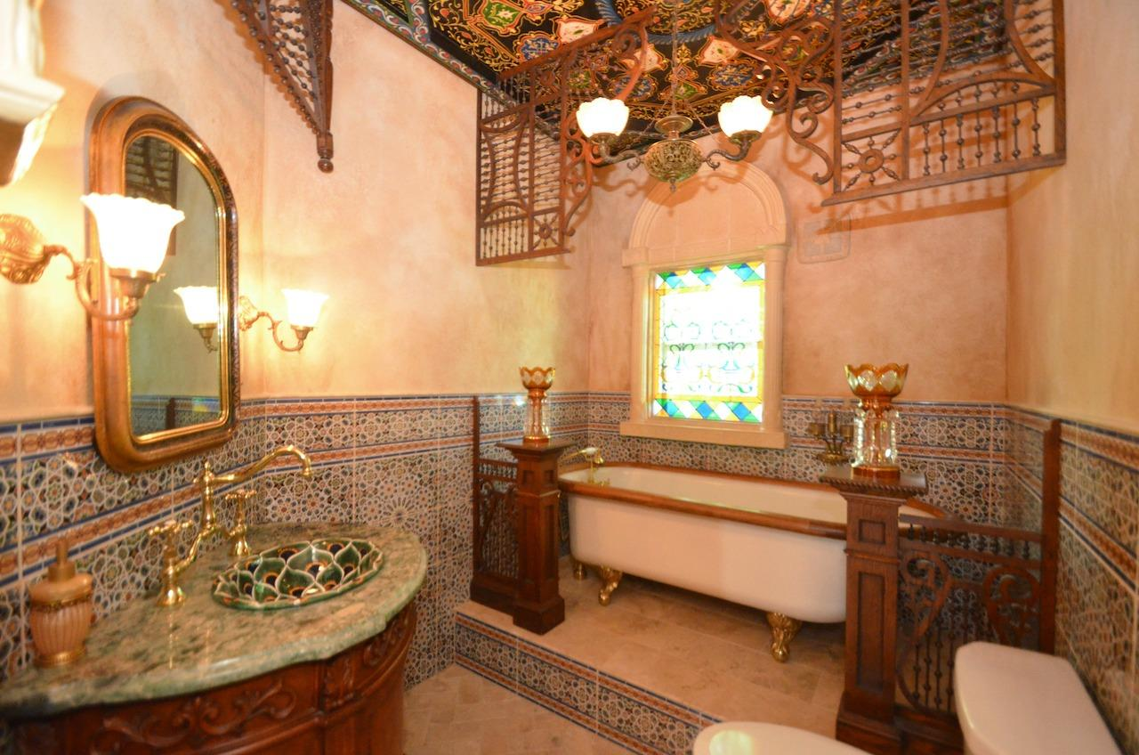 I think we all know what your guests will be talking about the morning after the party!  And because all of the bathrooms in the house are full baths, there is a claw foot tub, of course. Artisan Patrick Dougherty, known for his Rookwood tile designs, must be very proud of this creation indeed!