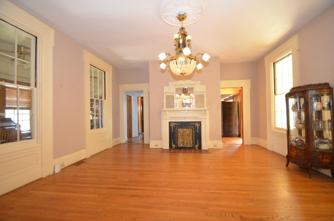 The formal dining room in flanked on either side by rooms that were once open porches.  Currently the office/den to the left and the sunny breakfast room to the right.  Go straight through and you are in the newly remodeled kitchen.