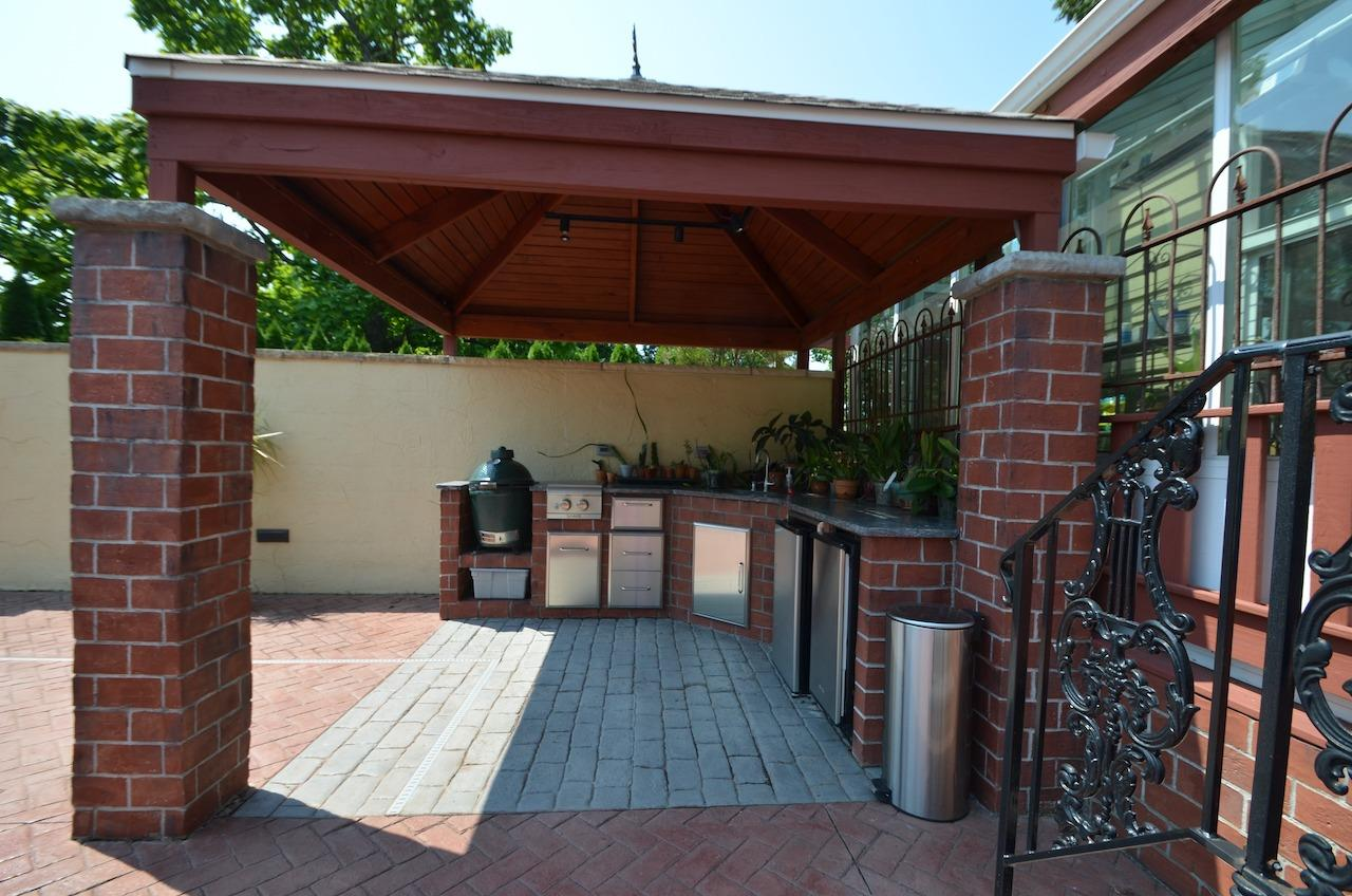Outdoor Kitchen.  Green Egg grill not included.  Roof of this structure was built to match roof of solarium.